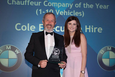 Derek Cole receiving the prestigious Silver award for chauffeur of the year from Amanda Hook-Brown of BMW Group UK